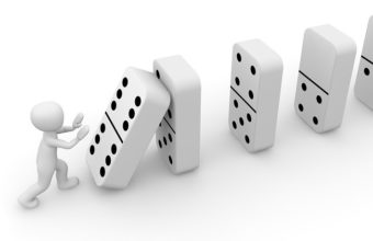 Line of dominos falling down